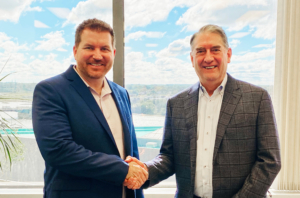 Two men shaking hands following the acquisition of the assets of the William Fall Group